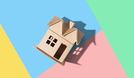 Cardboard house with drop shadow overhead view Stock Photo