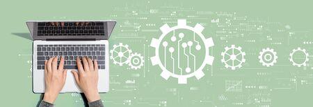 Automation concept with person using a laptop computer Banco de Imagens