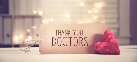 Thank You Doctors message with a red heart with heart shaped lights