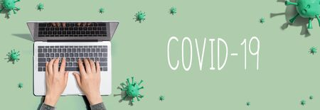 COVID-19 Coronavirus theme with person using a laptop computer