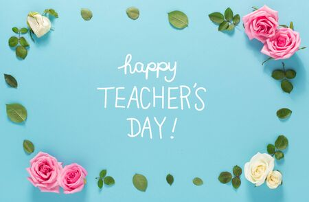 Teachers Day message with roses and leaves top view flat lay