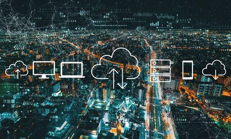 Cloud computing with aerial cityscape view of Japan at night