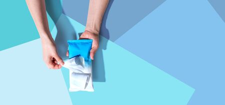 Sanitizer wipe - healthcare and hygiene concept - overhead view