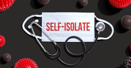 Self-isolate Covid-19 theme with medical mask and stethoscope Standard-Bild