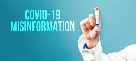 Covid-19 Misinformation theme with a doctor holding a laboratory vial on a blue background