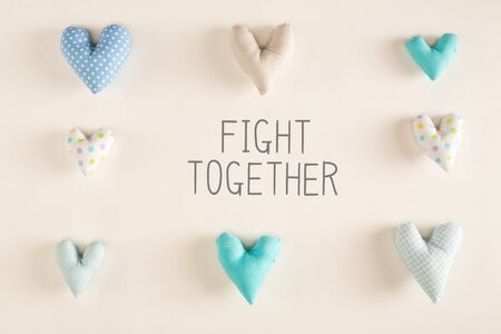 Fight Together message with blue heart cushions on a white paper background