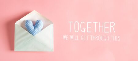 Together We Will Get Through This message with a blue heart cushion in an envelope