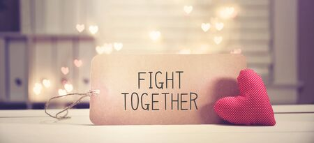 Fight Together message with a red heart with heart shaped lights