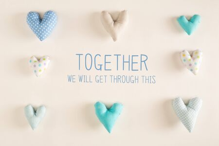 Together We Will Get Through This message with blue heart cushions on white