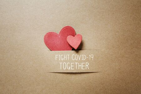 Fight Covid-19 Together message with handmade small paper hearts Banco de Imagens