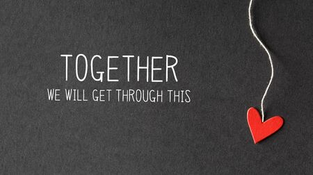Together We Will Get Through This message with handmade small paper hearts