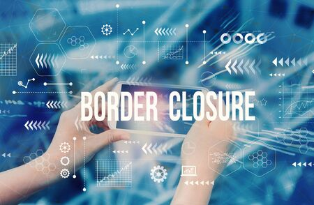 Border Closure Theme with person using a smartphone