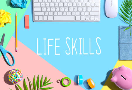 Life skills theme with office supplies and a computer keyboard Zdjęcie Seryjne