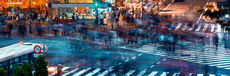 People and traffic cross the famous scramble intersection in Shibuya, Tokyo, Japan, one of the busiest crosswalks in the world