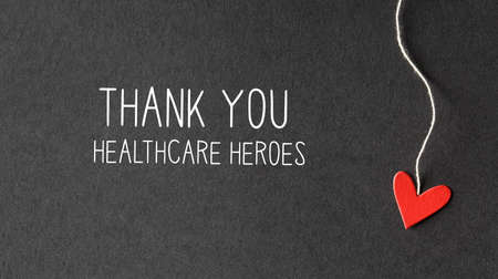 Thank You Healthcare Heroes message with handmade small paper hearts