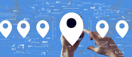 Map pin concept with person holding a white smartphone