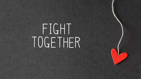 Fight Together message with handmade small paper hearts