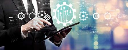 Automation concept with businessman using his tablet computer Banco de Imagens