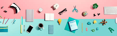 Collection of electronic gadgets and office supplies - flat lay