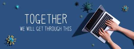 Together We Will Get Through This message with woman using a laptop computer Banco de Imagens