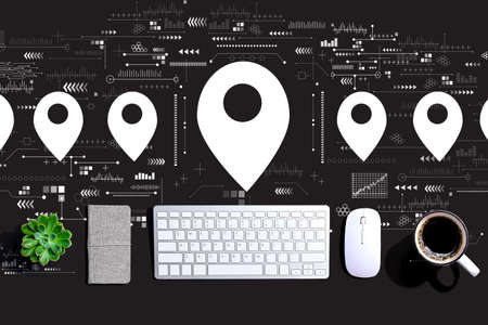 Map pin concept with a computer keyboard and a mouse Standard-Bild