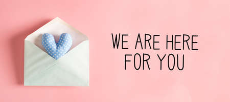 We are Here for You message with a blue heart cushion in an envelope Banco de Imagens