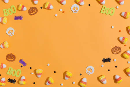 Halloween themed background border on a orange background