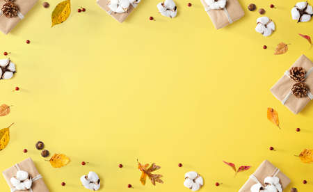 Gift boxes with autumn theme - overhead view flat lay