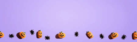 Miniature Halloween pumpkin ghosts with spiders - flat lay