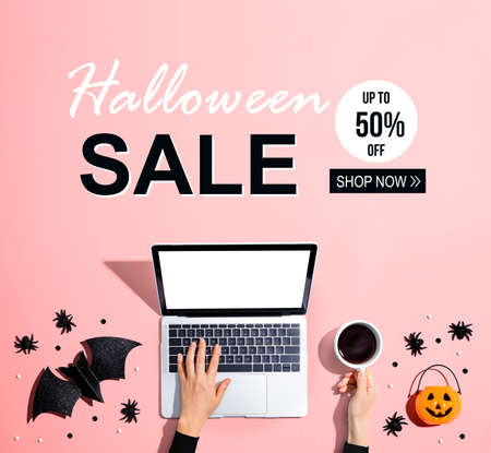 Halloween sale banner with laptop and Halloween decorations - flat lay