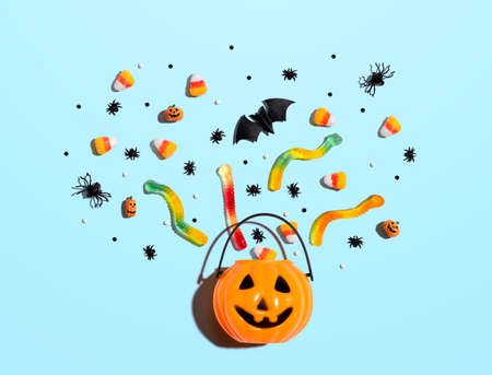 Halloween pumpkin with decorations - overhead view flat lay