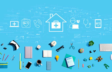 Telehealth theme with collection of electronic gadgets and office supplies