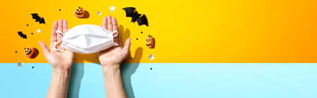Facial masks with Halloween objects - flat lay