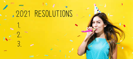 2021 Resolutions with young woman with party theme on a yellow background Banco de Imagens
