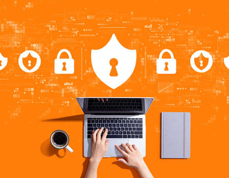Cyber security theme with person using a laptop computer