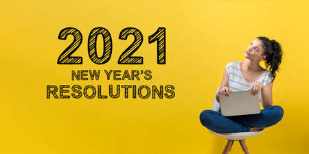 2021 New Years Resolutions with young woman using a laptop computer Foto de archivo