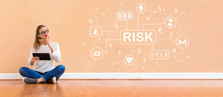 Cryptocurrency risk theme with young woman holding a tablet computer