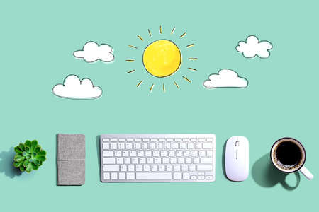 Sunny day concept with a computer keyboard and a mouse Фото со стока