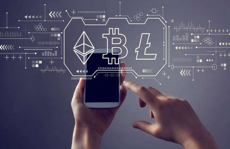 Cryptocurrency - Bitcoin, Ethereum, Litecoin with person holding a white smartphone
