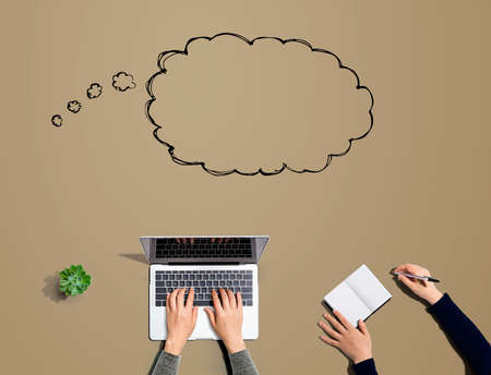 Blank speech bubble with people working together with laptop and notebook Фото со стока