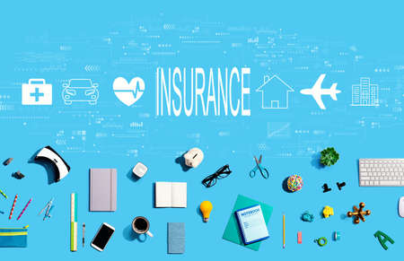 Insurance concept with collection of electronic gadgets and office supplies Фото со стока