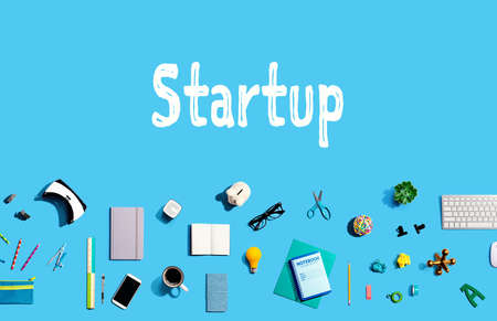 Startup with collection of electronic gadgets and office supplies
