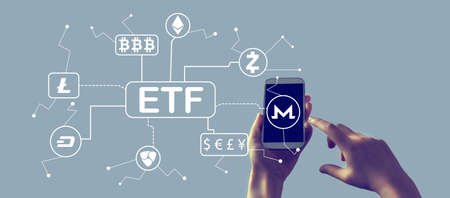 Cryptocurrency ETF theme with person holding a white smartphone