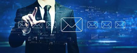 Email concept with businessman on a dark blue background Standard-Bild