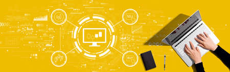 Stock trading theme with person working with a laptop
