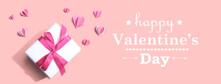 Valentines Day message with a gift box and paper hearts