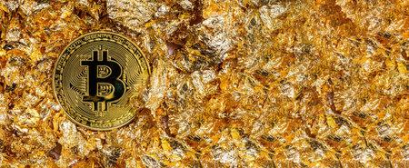 Physical golden Bitcoin coin on gold leaf Standard-Bild