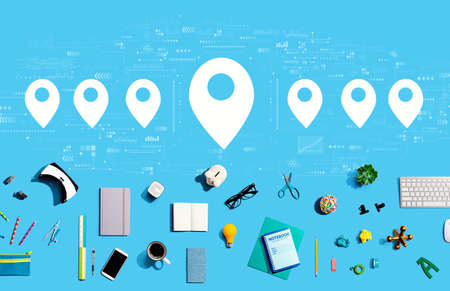 Map pin concept with collection of electronic gadgets and office supplies Standard-Bild