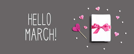Hello March message with a gift box and paper hearts