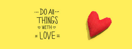 Do all things with love message with a red heart cushion - flat lay